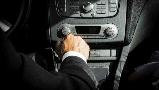 Driver with hand on gear stick