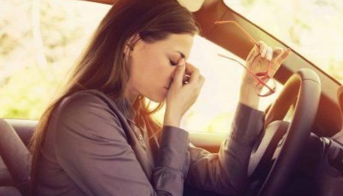 Driver rubbing eyes