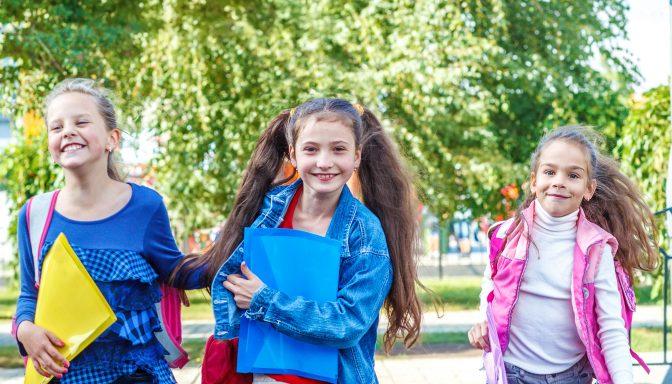 Girls crossing road shutterstock 149405798