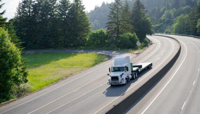 White lorry on empty road
