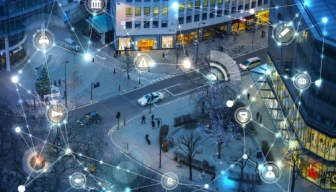 Connected vehicles on street at night