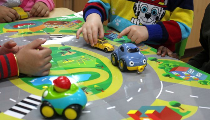 Children playing cars