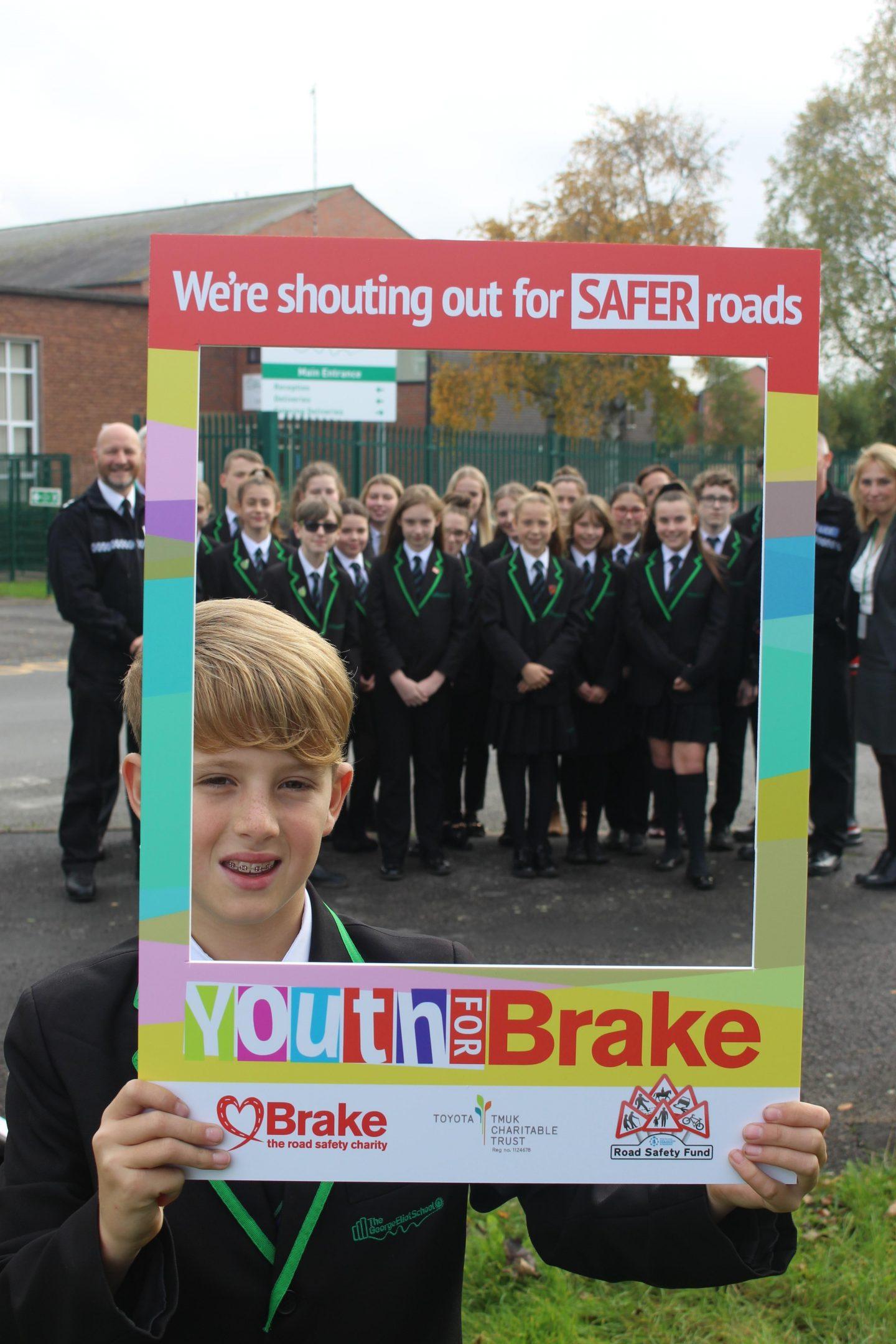 Y4 B Warwickshire George Elliot School Boy in front of group